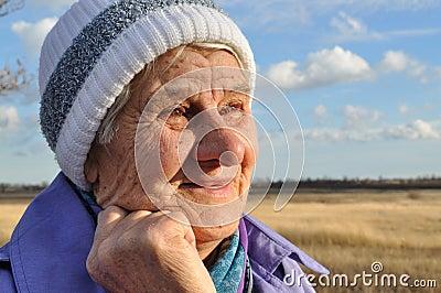Joyful, an elderly woman