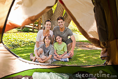 Joyful family camping in the park