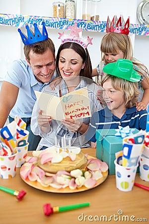Joyful family celebrating mother s birthday