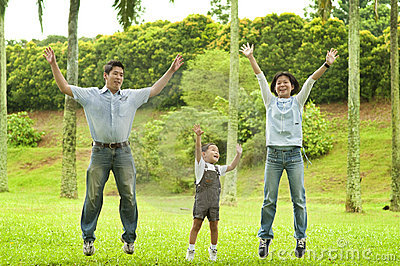Joyful family jumping together