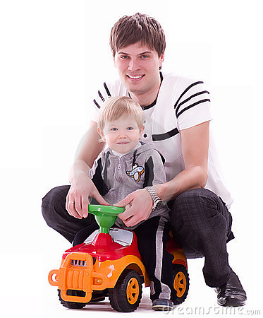 Joyful father and his baby son with small car