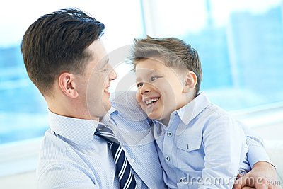 Joyful father and son