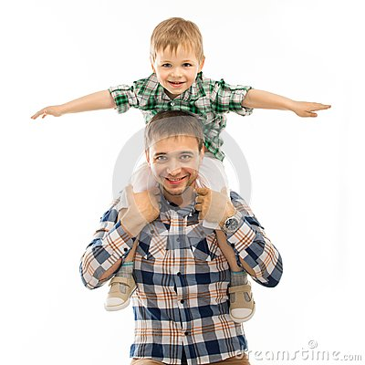 Joyful father with son on shoulders