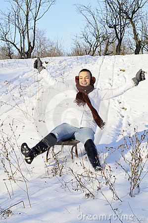 Joyful female relaxing in winter