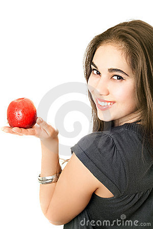 Joyful girl with an apple