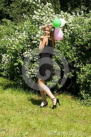 Joyful girl with balloons