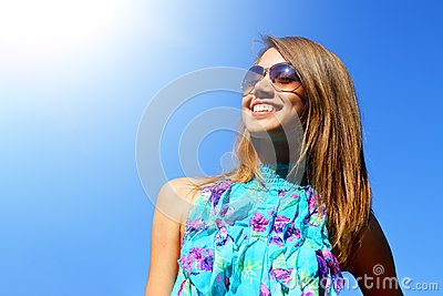 Joyful girl on a blue background