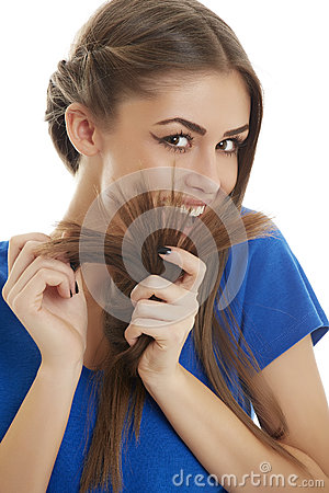 Joyful girl playing with her hair