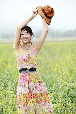 Joyful girl in rape field