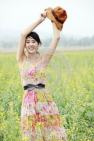 Joyful girl in rape field
