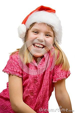 Joyful girl in Santa hat
