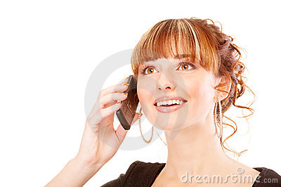 Joyful girl speaks by phone