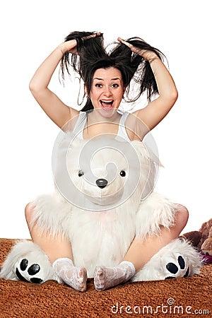 Joyful girl with a teddy bear