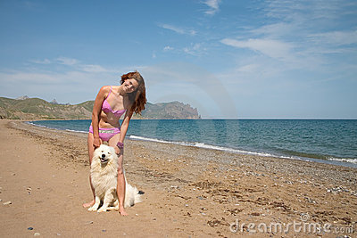 Joyful girl together with samoyed