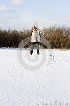 Joyful girl walking in winter