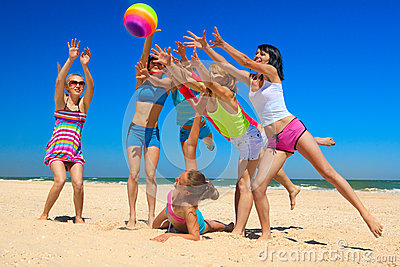 Joyful girls playing volleyball
