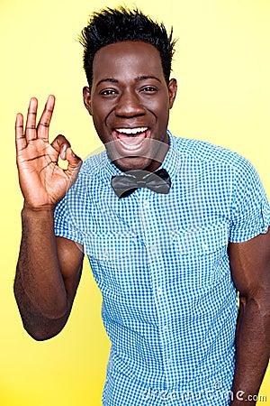 Joyful guy showing excellent gesture