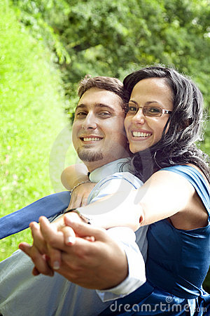 Joyful happy young couple having fun