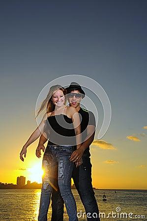 Joyful hispanic couple at sunset