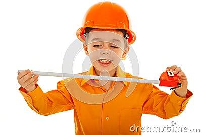 Joyful kid with measure tool