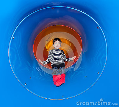 Free Joyful Kid Sliding In Tube Slide Stock Images - 28247334
