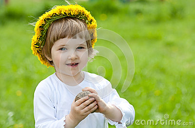 Joyful little girl in yellow chaplet