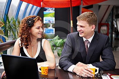 Joyful man and woman on business lunch