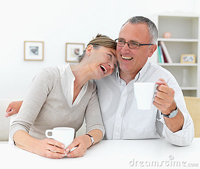 Joyful mature couple having a laugh