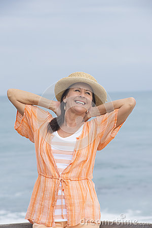 Joyful mature woman ocean beach