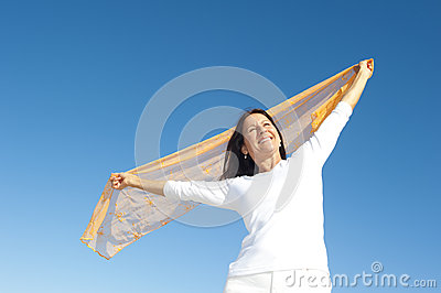 Joyful mature woman sky