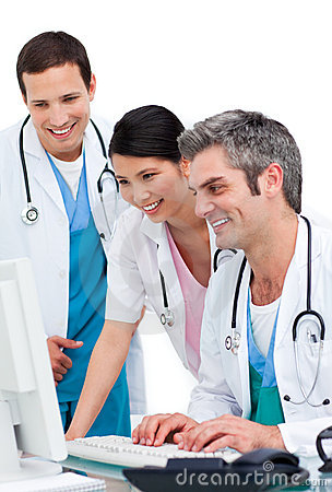 Joyful medical team working at a computer
