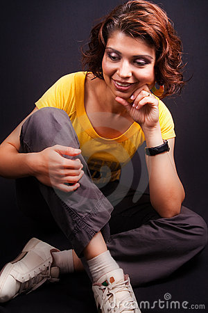Joyful middle aged woman sitting down
