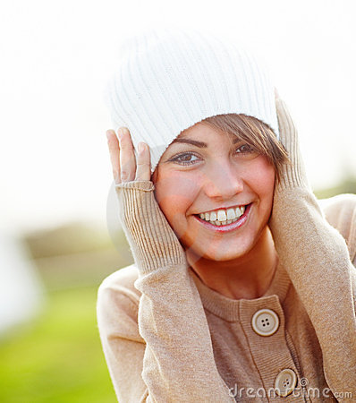 Joyful  modern woman smiling outside
