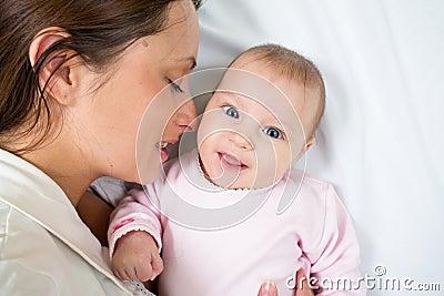 Joyful mother with her daughter baby girl