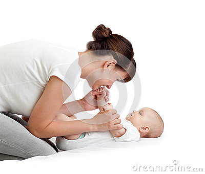 Joyful mother playing with her baby infant