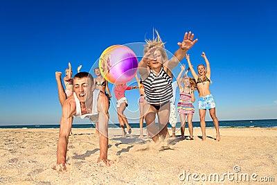 Joyful people playing volleyball