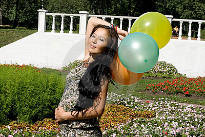 Joyful pregnant girl with colorful balloons