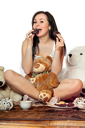 Joyful pretty girl eating chocolate biscuit