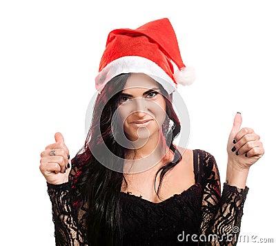 Joyful pretty woman in red santa claus hat
