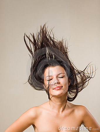Joyful relaxed brunette with flowing hair.