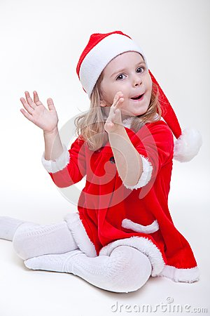 Joyful santa girl on white
