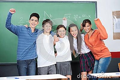 Joyful Schoolchildren Standing Together In