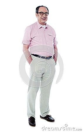 Joyful senior man posing casually