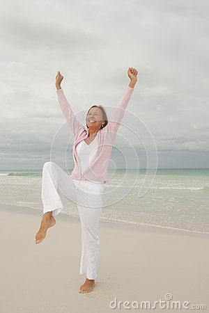 Joyful senior woman  ocean background