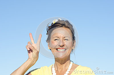 Joyful senior woman sky background