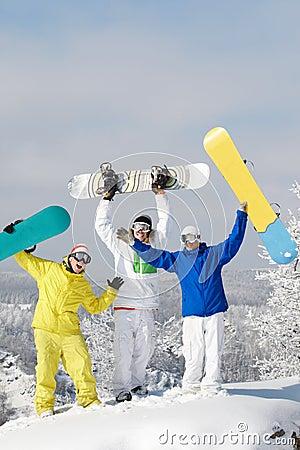 Joyful snowboarders