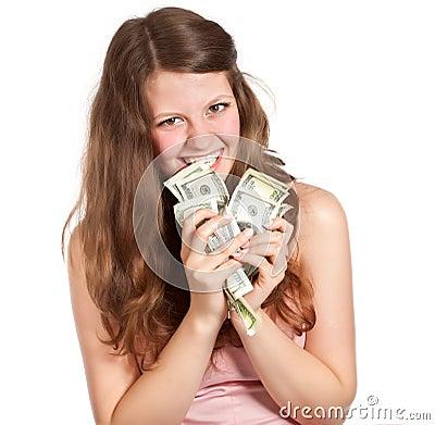 Joyful teenage girl with dollars in her hands