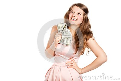 Joyful teenage girl with dollars in her hands