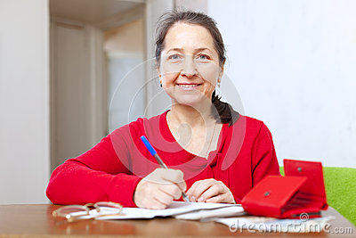 Joyful  woman with bill and money