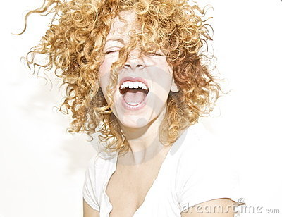 Joyful woman with curls